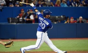 Apr 24, 2016; Toronto, Ontario, CAN;  Toronto Blue Jays third baseman Josh Donaldson (20) hits a double against Oakland Athletics in the third inning at Rogers Centre. Mandatory Credit: Dan Hamilton-USA TODAY Sports